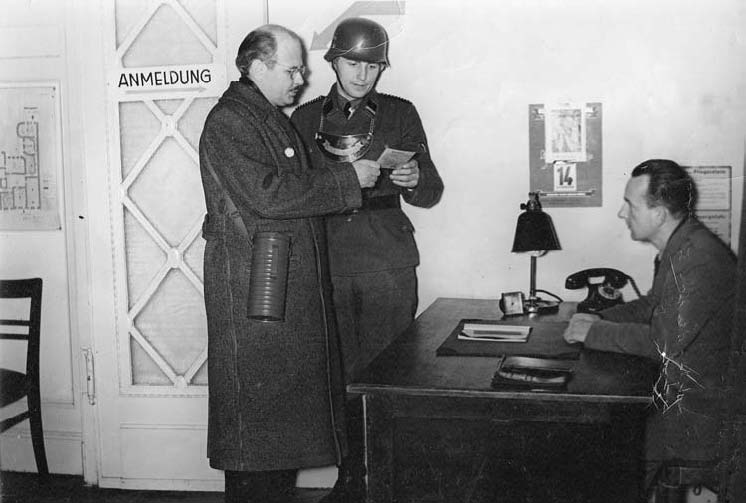 Shirer discusses a script with censors at the Berlin broadcast centre, circa 1939.